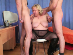 Busty blonde old granny swallows two cocks