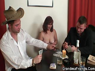 Superannuated bitch in stockings takes twosome rods