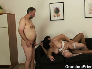 Granny in white underclothing swallowing two cocks after pussy toying