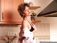 Granny Hannah with smallish baps gets herself off in kitchen