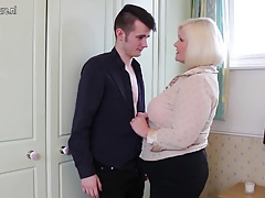 Big Brit mother playing with young toy boy