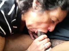 Grannie slurping a lenghty black meatstick