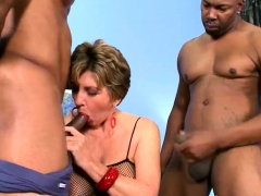 Busty grannie fucked by two dark-hued guys